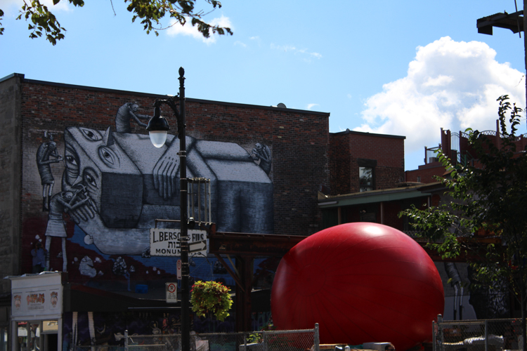 Redball Project on St. Laurent. Artist Kurt Perschke. Photo Magali Crevier