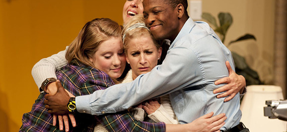 Family Hug.Cast: Emily Tognet as Sarah (left); Jane Wheeler as Val (back); Jaa Smith-Johnson as Deng (right) and Eleanor Noble as Jackie (center) Credit: Andrée Lanthier