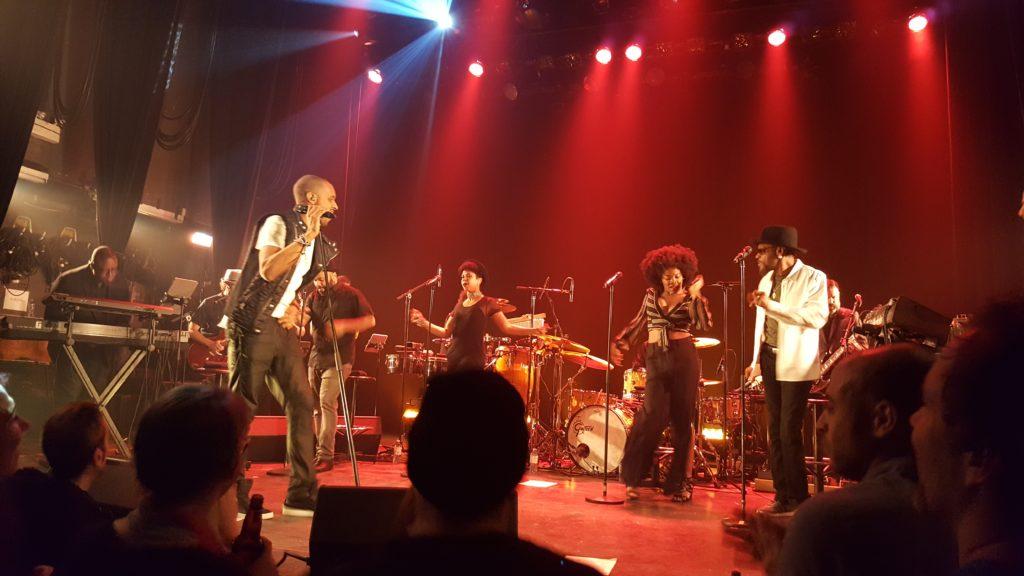 Fredy V (front) & singers. Photo Belinda Belice.